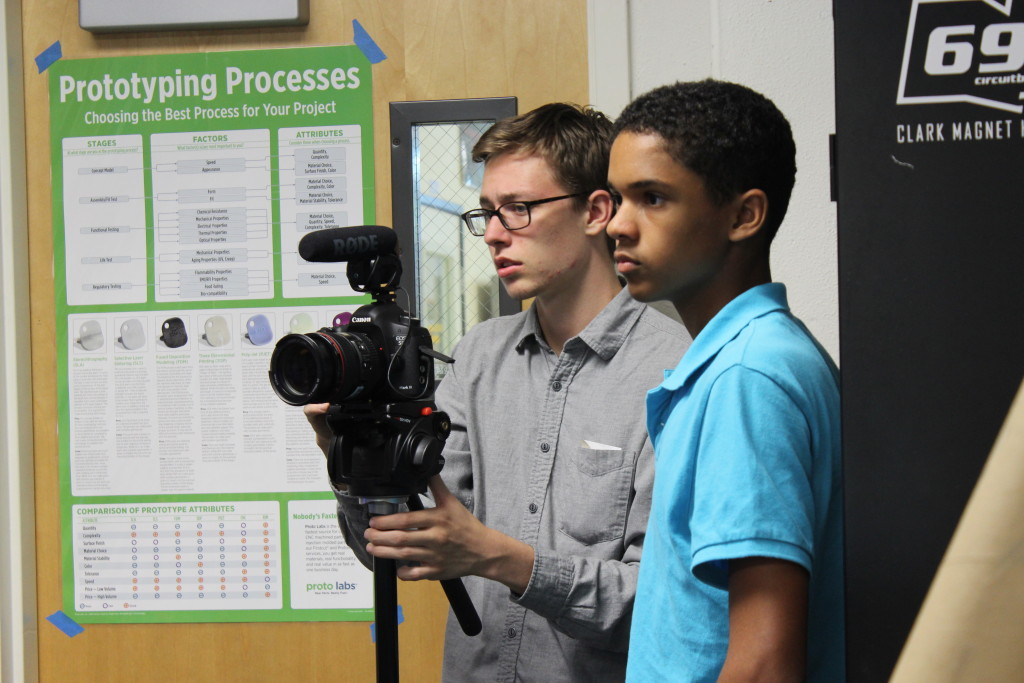 Josiah and Chris setup video-recorder for Armand while in the Business sub-team room.