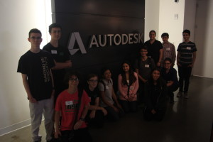 Students posing for photo at Autodesk's software headquarters.