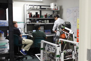 Bhavin, Daniel, and Jake Z. working hard in the Programming team's room.