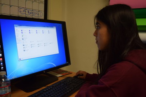 Andrea working on the spreadsheets.